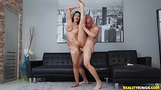 Lay bare guy pleased Katana Kombat with hardcore sex on black sofa